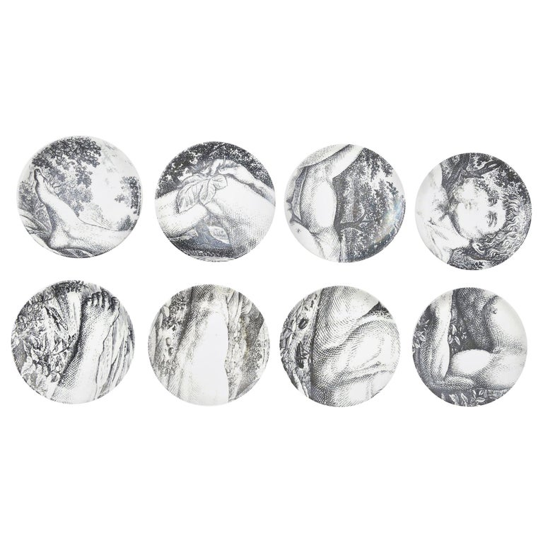These interactive set of eight Piero Fornasetti porcelain Mid-Century Modern coasters and or small plates are of the allegorical and biblical