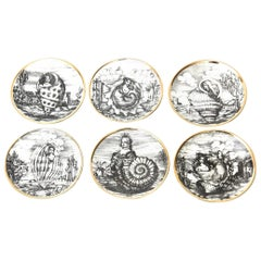 "Piero Fornasetti Porcelain Gilded Coasters Titled ""Le Oceandi"", Set of 6 Barware"