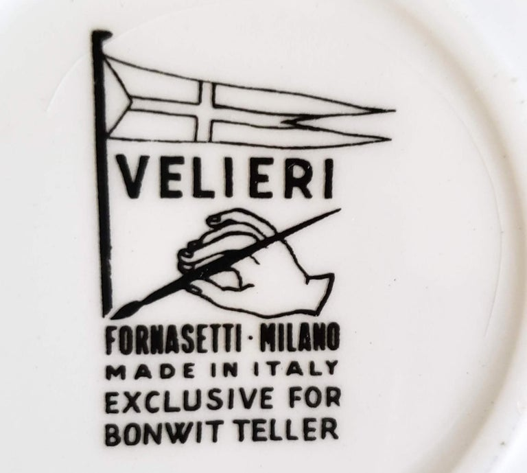 Piero Fornasetti Porcelain set of eight ship coasters, Velieri with original box, circa 1960  The complete set of eight Piero Fornasetti coasters each depict a different Spanish galleon. The coasters come with their original gold box.   The