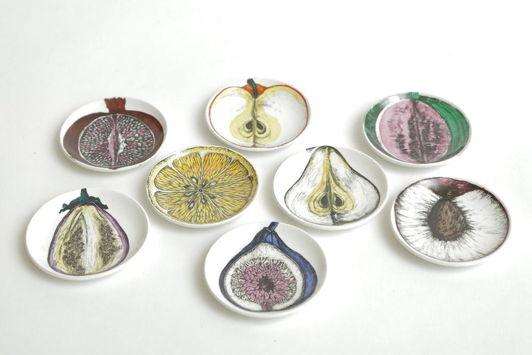 This very rare and perhaps never used complete set of 8 Italian Piero Fornasetti porcelain small plates or coasters are signed and titled Sezoni Di Frutta. They are Mid-Century Modern and in their original yellow box with the paper dividers from the