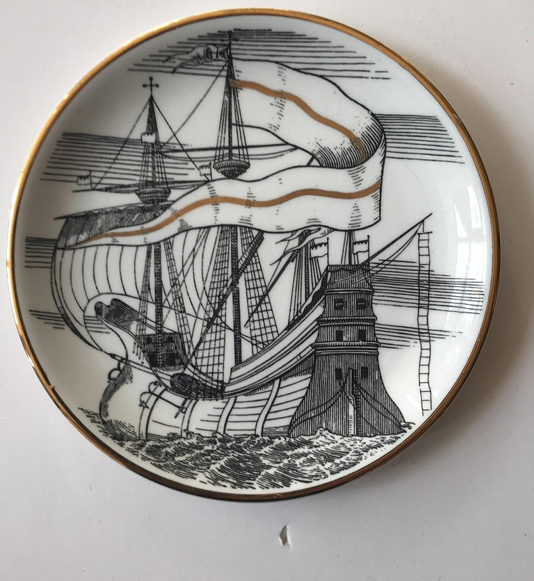 Set of five beautiful Piero Fornasetti Italian porcelain coaster depicting Spanish galleons or ships. Each is different. The coasters were made exclusively for Bonwit Teller. The reverse of each is printed with the Fornasetti Milano mark. Great as