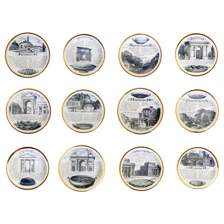 Piero Fornasetti Specialità Milanese Set of Twelve Porcelain Plates, 1960-1970 For Sale