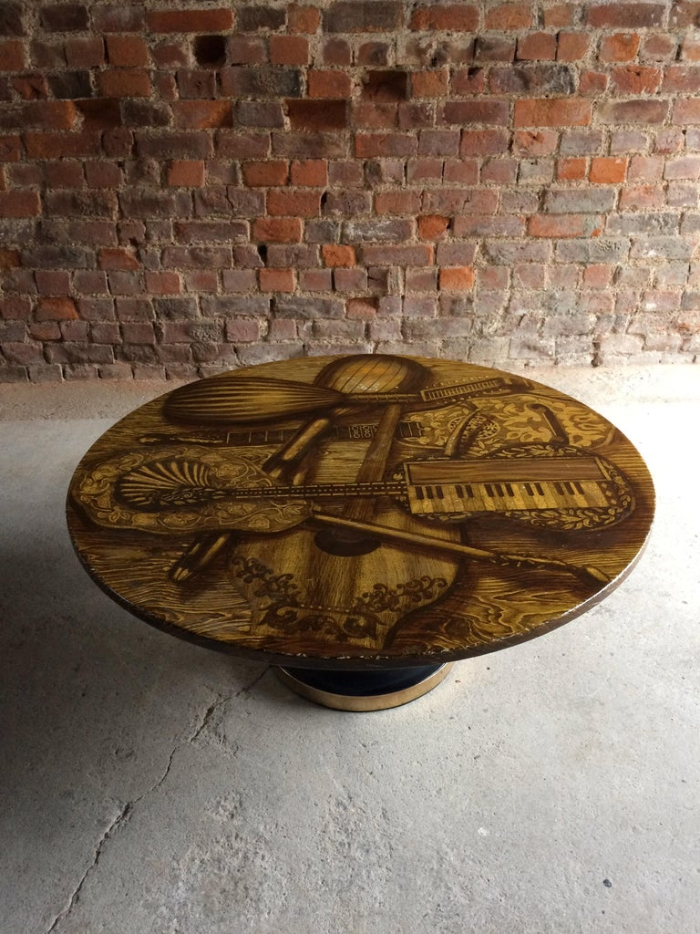 Magnificent Piero Fornasetti, Italy, 1960s circular Musical Instrument coffee table, or 'Strumenti Musicali' with musical instrument design top, on black enamelled metal base with brass strip.  Condition: This item is offered in good original