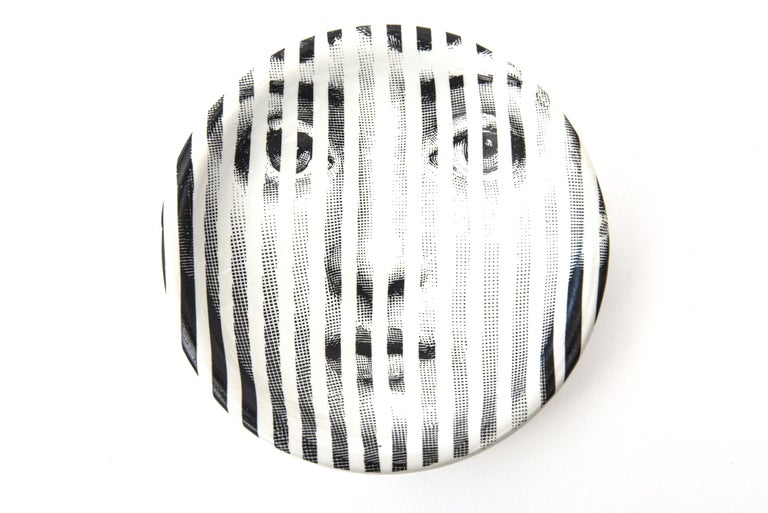 This amazing vintage Piero Fornasetti porcelain bowl is of the Tema Variation series and of the muse of Fornasetti's whom was the opera singer, Lina Cavalieri. Fornasetti was the Fellini of Italian design. His prolific and creative career and life