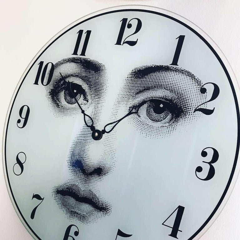 Piero Fornasetti wall clock created in 1990s. Glass clock face with printed woman face and digits with Quartz clockwork. Measures: Ø 37 cm.