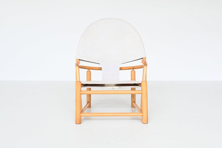 Beautiful shaped lounge chair model G23 Hoop chair designed by Piero Palange and Werther Toffoloni and manufactured by Germa, Italy 1972. This very nice chair features a solid bent beechwood frame with a canvas upholstery. It has a very nice hoop