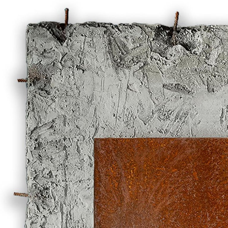 Cement and corroded steel on foam panels.  Auville works with construction cement. Applying techniques used in the construction and ship building industries, he spreads the cement over high-density foam panels, creating pieces ranging in size from
