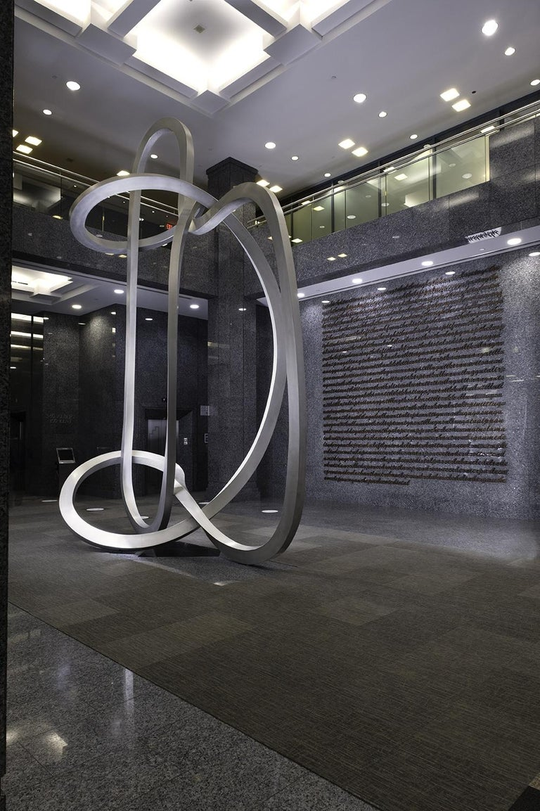 Smooth looping and folding rectangular tubes in curvilinear aluminum, Pierre Bourgault was inspired by traditional Inuit string games. This sculpture is a monumentalized string game. Originally realized in two parts for corporate commission,