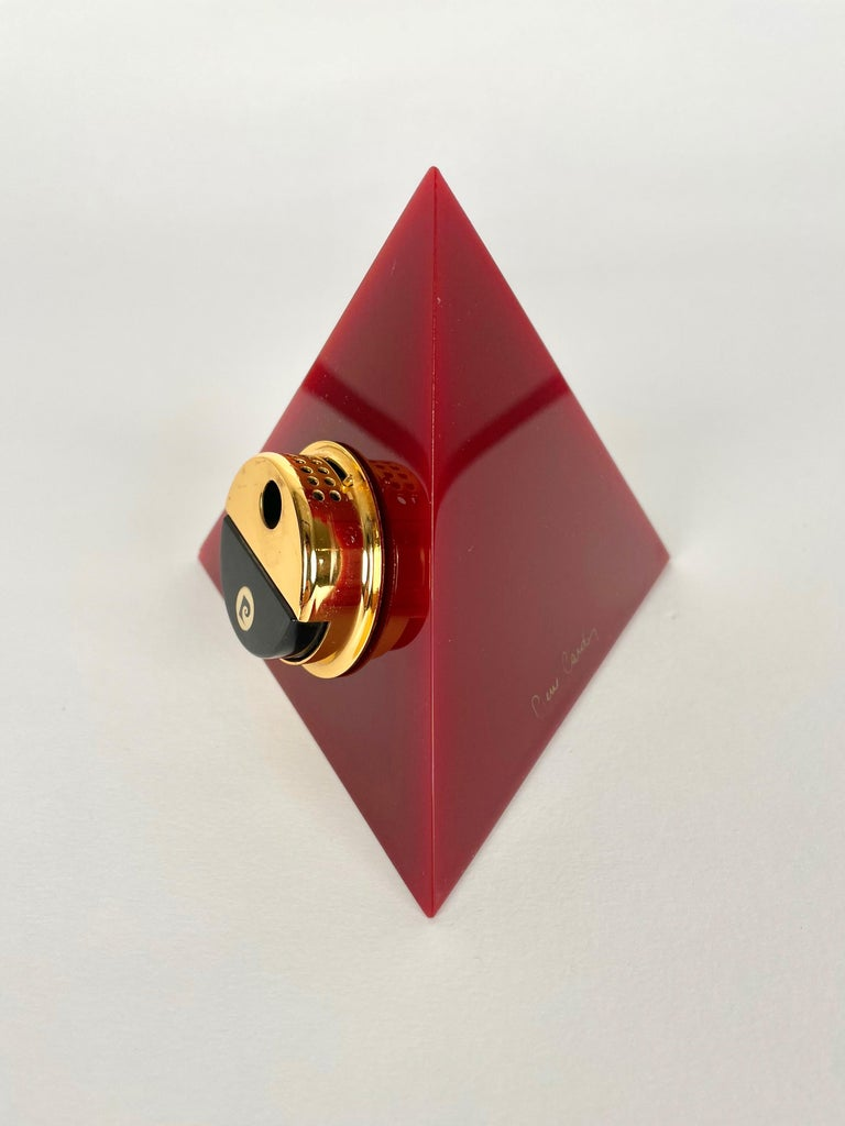 Pyramidal table lighter in bordeaux acrylic by Pierre Cardin (original signature still visible) made in France in the 1970s.