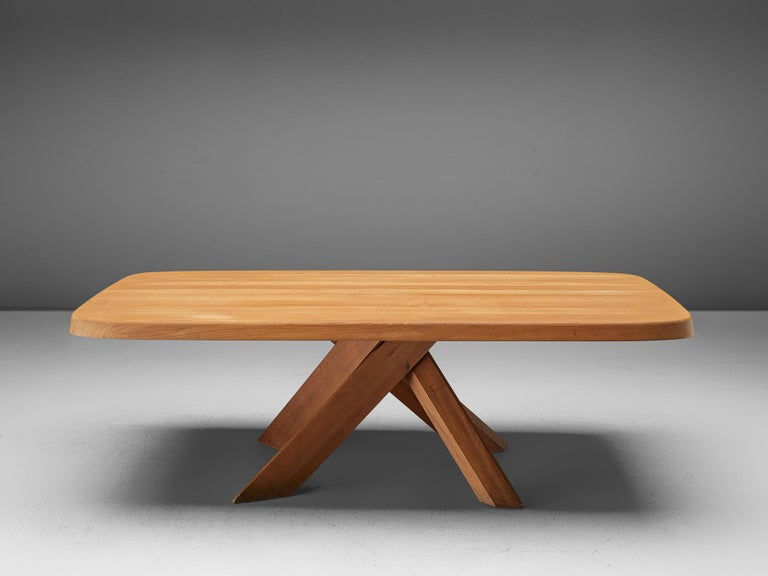 Pierre Chapo, dining table model Aban T35D, solid elm, France, circa 1972  Pierre Chapodesigned the dining table Aban T35D circa in 1972. The rectangular tabletop shows rounded corners and sits on a dyanamic base out of four wooden legs