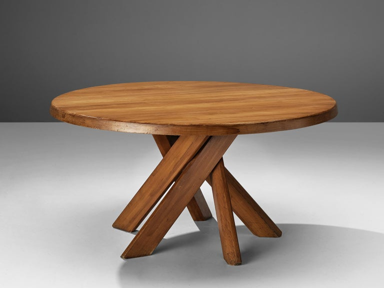 Pierre Chapo, dining table model 'T21D', elm, France, 1960s  This round dining table is designed by Pierre Chapo. The shape of the base creates a very dynamic look. The perfectly made solid wood joints, also shown on the side of the top with