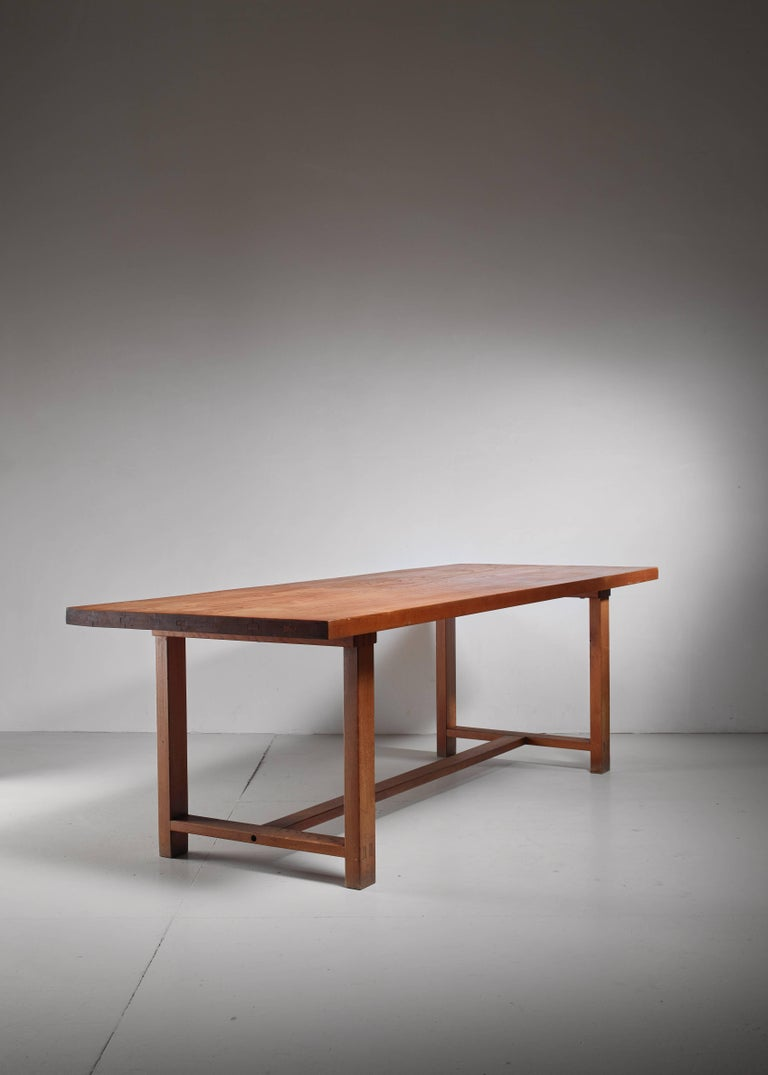 A rare Pierre Chapo model T01C dining table.