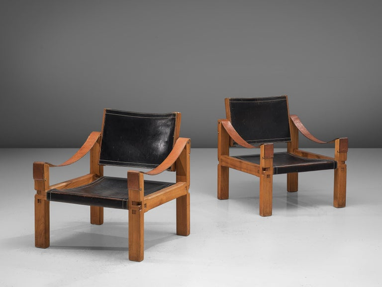 Pierre Chapo, two armchairs, model S10X, elm and leather, France, circa 1964.  This set of two lounge chairs is designed by Pierre Chapo. These comfortable armchairs in solid elmwood and black saddle leather of this specific set features a