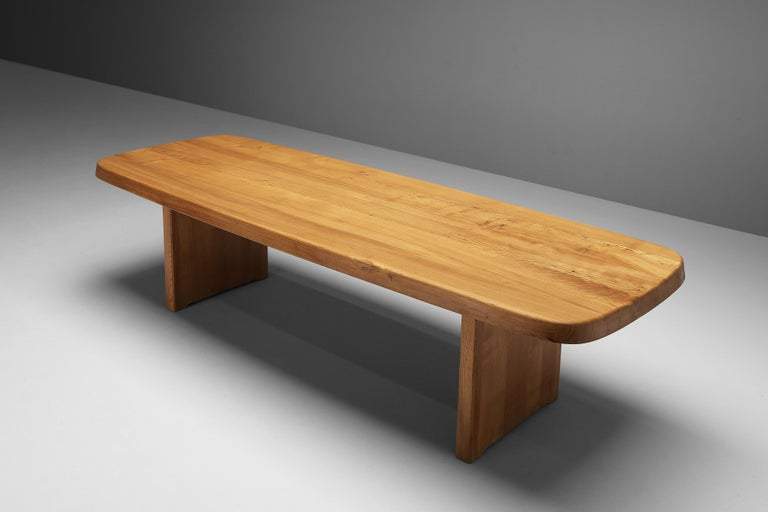 Pierre Chapo, large dining table T20B, elm, France, 1960s  The rectangular tabletop of the T20B with sloping edges, rests on a two-legged base. Strong and simplified design which clearly emphazises the expression of the grain and the natural look.