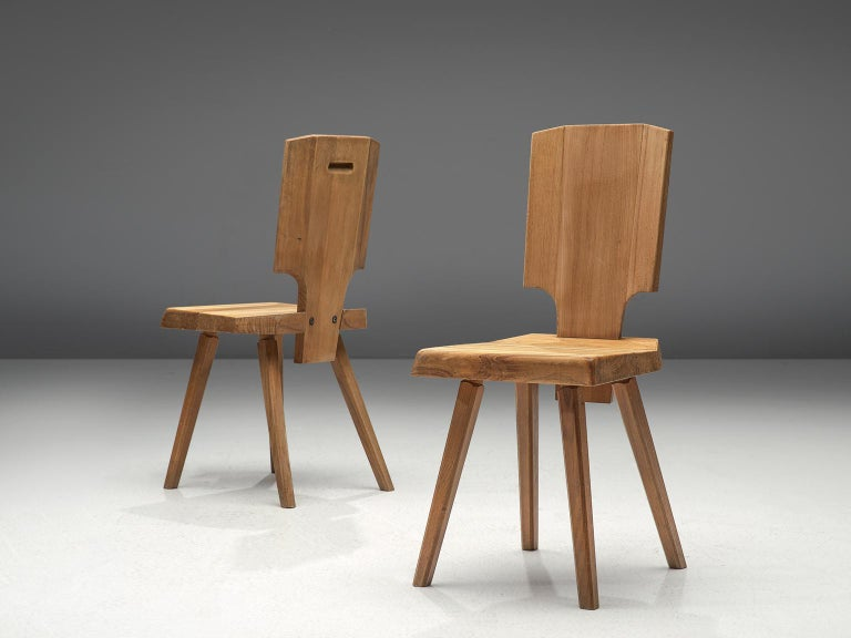 Pierre Chapo, 2 S28 dining chairs, elmwood, France, design 1972, manufactured 1972-1974.  During his travels to Alsace, Chapo discovered the Alsatian architecture and got inspired to modernize the