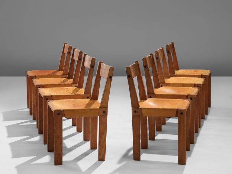 Pierre Chapo, set of eight dining chairs, model S24, elm and leather, France, circa 1966.  A set of 8 chairs in solid elmwood with saddle leather seating and back. Designed by French designer Pierre Chapo in Paris. These chairs have a cubic design
