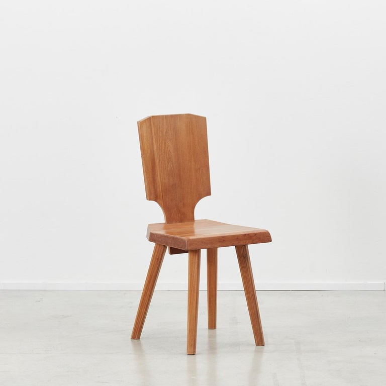 Pierre Chapo S28 early production dining chairs made from solid elmwood, designed in 1972, produced late 20th century. The S28 was inspired by Chapo's travels to Alsace. He wanted to reinvent a typical Alsatian folk chair, without its decorative