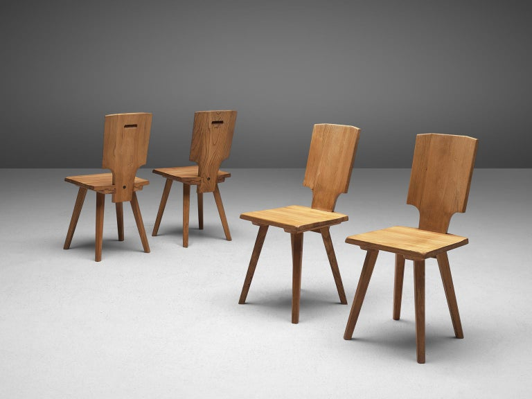 Pierre Chapo, set of 4 S28 dining chairs, elmwood, France, design 1972, manufacture 1975  During his travels to Alsace, Chapo discovered the Alsatian architecture and got inspired to modernize the