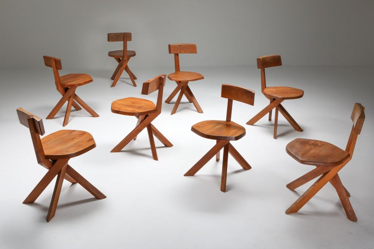 Mid-Century Modern solid elm S34 dining chairs in by Pierre Chapo, France, 1960s.  These chairs have the typical playful and majestic characteristics of Pierre Chapo's iconic designs. Asymmetric but yet in perfect balance. The cross legged base