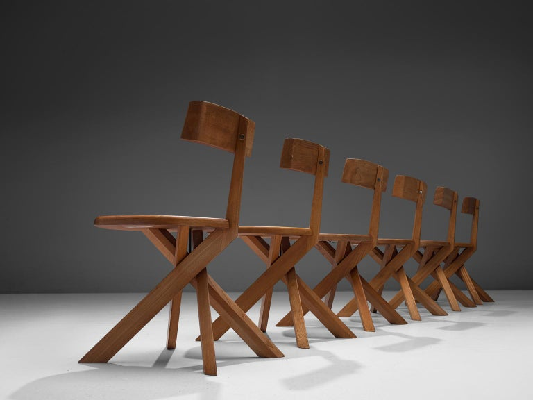 Pierre Chapo, 'S34' dining chairs, Elmwood, France, 1960s  These asymmetrical chairs with twisted base are true icons of Pierre Chapo's playful and solemn designs. The backrest is placed just slightly out of the middle, this imperfection has to