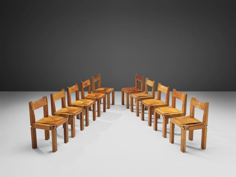 Pierre Chapo, set of tendining chairs, model S11, elm and leather, France, circa 1966.  A set of ten chairs in solid elmwood with cognac leather seating and back, designed by French designer Pierre Chapo. These chairs have a cubic design of solid