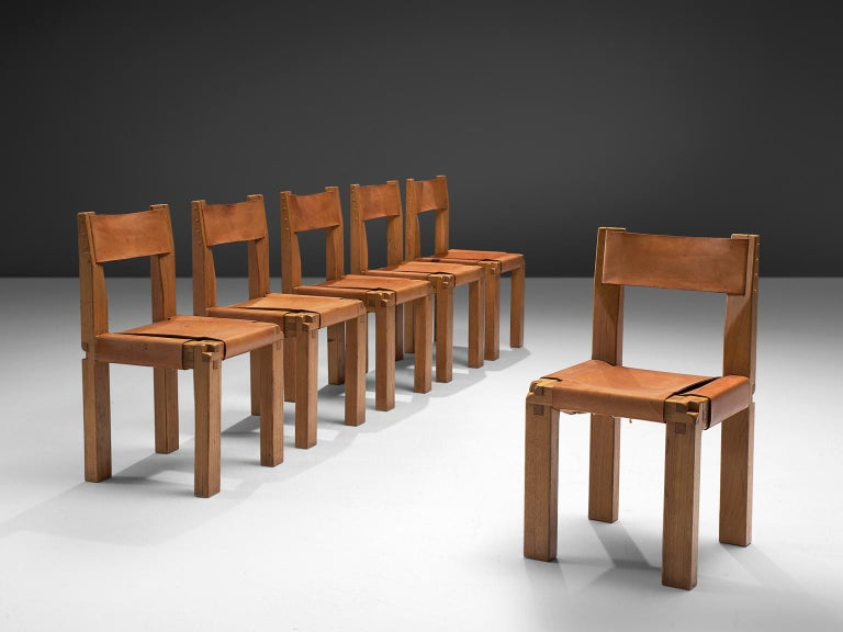 Pierre Chapo, set of six dining chairs, model S11, elm and leather by France, ca. 1966.  Large set of six chairs in solid elmwood with saddle leather seating and back. Designed by French designer Pierre Chapo in Paris. These chairs have a cubic
