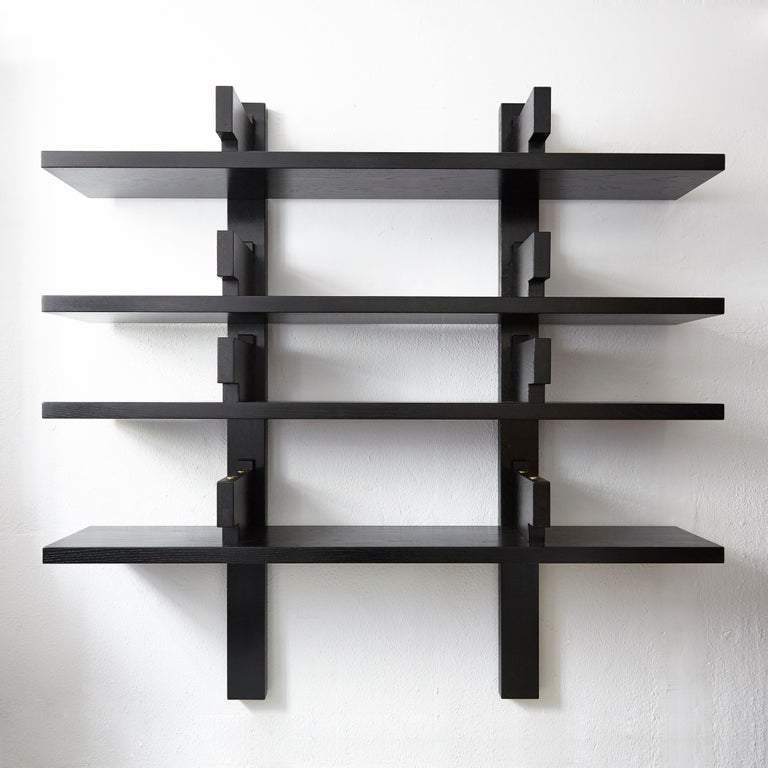 Special black edition of B17 wall-mounted book shelve designed by Pierre Chapo, circa 1970 in France. Manufactured by Chapo Creation, 2019. Oakwood.  In original condition, with wear consistent with age and use, preserving a beautiful