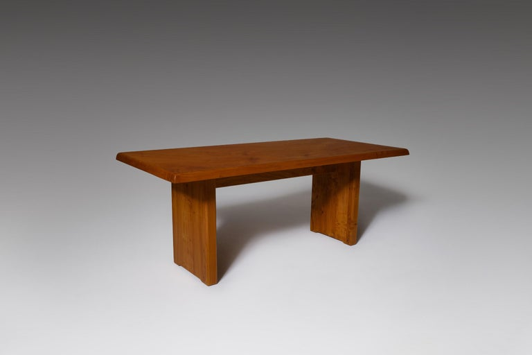 Rectangular 'T14C' dining table by Pierre Chapo, France, 1960s. Remarkable design made of solid warm colored elmwood with a beautiful exposed grain, giving the table a rich, warm and natural appearance. The top has nice skew lined edges which shows