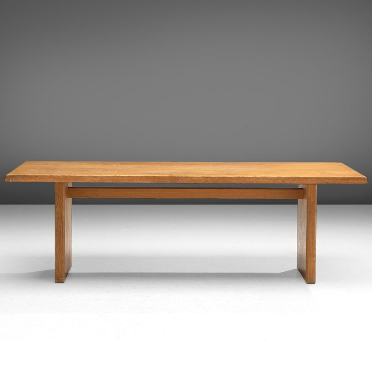 Pierre Chapo, dining table model T14D, oak, France, design 1960s, later production.  This dining table is designed by the French designer Pierre Chapo. The rectangular tabletop with sloping edges, rests on a two-legged base. Strong and simplified