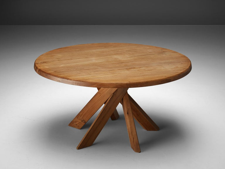 Pierre Chapo, dining table model T21, elm, France, 1960s  This round dining table is designed by Pierre Chapo. The shape of the base creates a very dynamic look. The perfectly made solid wood joints, also shown on the side of the top with double