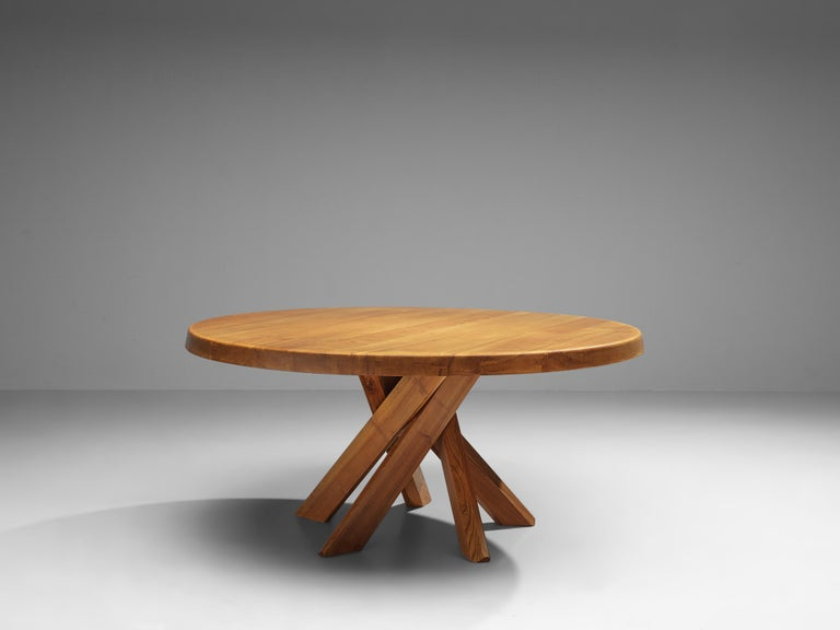 Pierre Chapo, dining table model T21 'SFAX', elm, France, 1960s  This round dining table is designed by Pierre Chapo. The shape of the base creates a very dynamic look. The perfectly made solid wood joints, also shown on the side of the top with