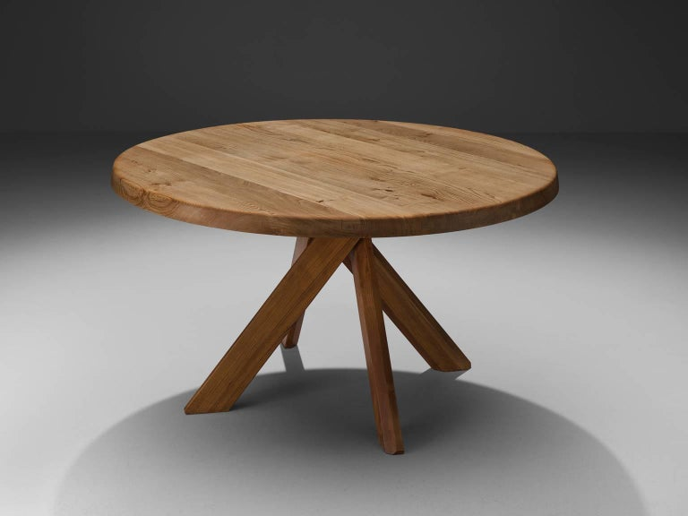 Pierre Chapo, round T21C dining table, elm, France, ca. 1973.  The basic design and constructions, as well as the use of solid Elmwood characterizes the work of Chapo. The interesting base of the table is build with 5 stems, with angled edges to