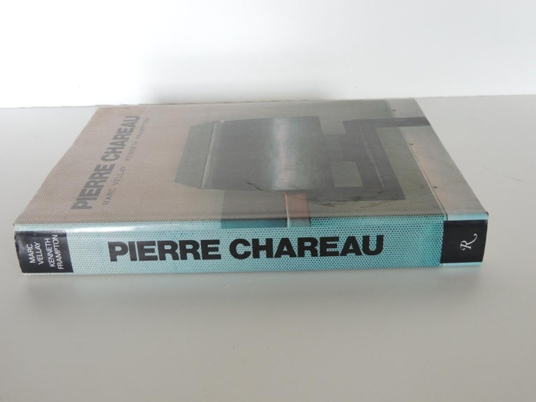 Pierre Chareau vintage coffee table hard-cover book by Marc Vellay and Kenneth Frampton for Rizzoli (1990) This is a first English edition of the monograph on the important architect and designer Pierre Chareau (1883-1950). The book 347 pages are