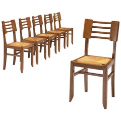 Pierre Cruège Set of Six Dining Chairs in Oak and Cane