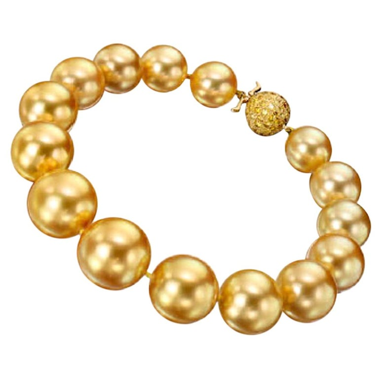 15 true gem natural color, deep golden South Sea pearls slightly graduating in size, from 10.5 up to 14.35 mm.  The color is a vibrant deep gold color, the skins are clean with fine deep luster and these spherical pearls are well matched.   We see