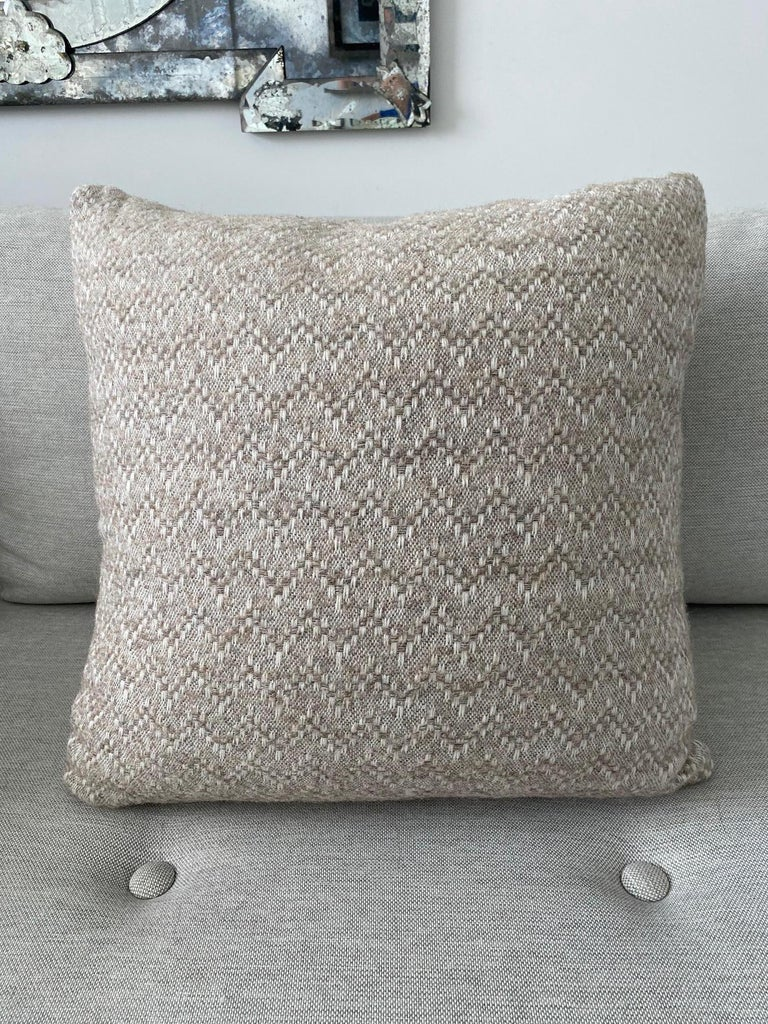 Handcrafted throw pillow made in Pierre Frey's Eva Racine. The large pillow features a blend of organic alpaca, mohair, and merino wools to create this stunning woven textile with a modern chevron pattern. Pillow features the same fabric on both