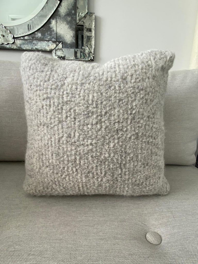 Custom throw pillow made with Pierre Frey's Scarlette Plume which features a blend of alpaca, mohair, and merino wools to create this stunning woven texture. The reverse side of the pillow is equally as beautiful and features full grain taupe