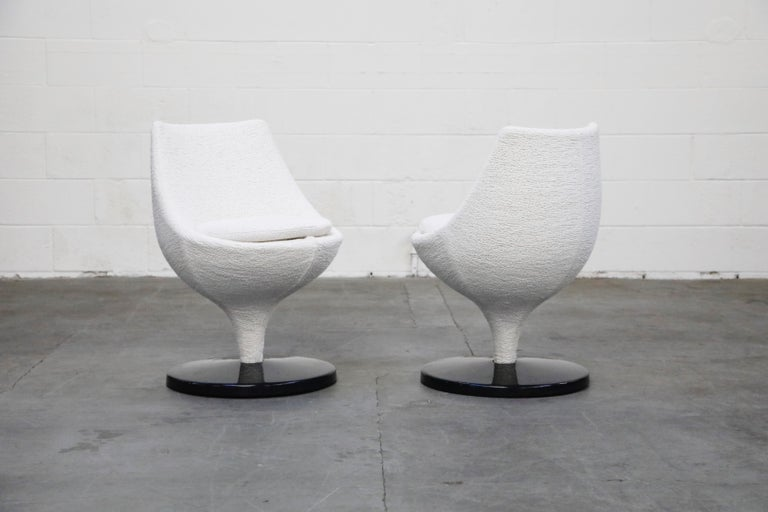 A pair of beautiful Pierre Guariche for Meurop circa 1965 'Polaris' swivel chairs in a highly textured white boucle fabric and black fiberglass base. Pierre Guariche, a French designer and Meurop a Belgian maker. Recently reupholstered, in showroom