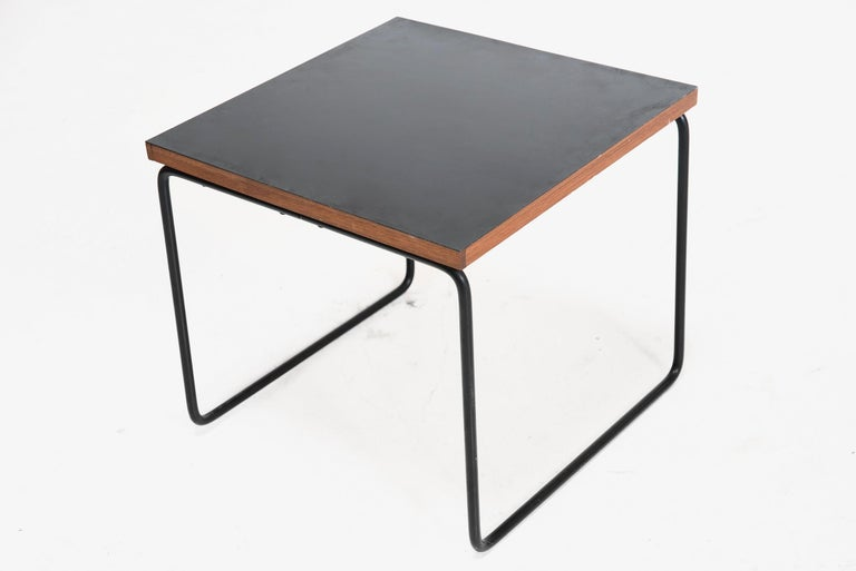Pierre Guariche (1926–1995)  Side table Manufactured by Steiner France, 1950s Metal, formica  Measurements 39 cm x 39 cm x 36h cm 15.36 in x 15.36 in x 14.18 in  Provenance Private collection, France  Biography The architect Pierre Guariche was one