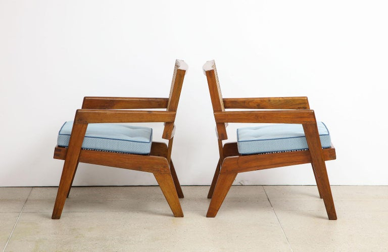 Rare pair of armchairs by Pierre Jeanneret. Open armchair model. Teak, rattan and upholstered cushion. Originally design for the University of Punjab, Chandigarh, India. Very good vintage condition with newly made seat cushions.