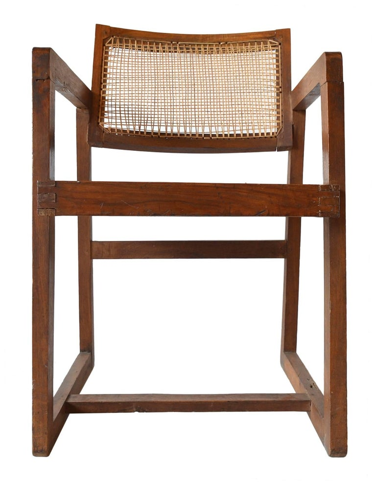A teak armchair made for the Punjab University in Chandigarh, India, circa 1960. Model number PJ-SI-53-A This rare chair is in original as found condition. Only wax and oil have been applied to preserve the original patina and history. Re-caned