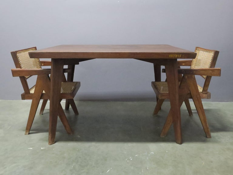 Original teak dining table from Chandigarh, India by Pierre Jeanneret. Solid teak construction.