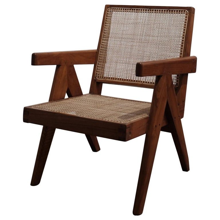 """Pierre Jeanneret, (1896-1967)  Pierre Jeanneret """"Easy Armchair"""" or """"Cane and teak wood Easy armchair"""", PJ-SI-29-A, circa 1955-1956.  Chair structure with teak, seat, and back in cane.  Model designed for various administrative buildings in the"""