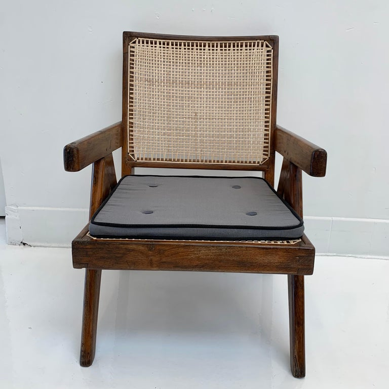Fantastic collection of Pierre Jeanneret 'Easy' chairs / lounge chairs. Model PJ-SI-29-A. 10 available. Priced individually. All in very good condition. Teak, cane and upholstered cushion. Well documented chairs and piece of collectible design.
