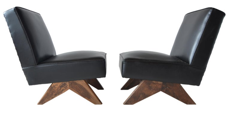 A pair or incredibly rare low armless easy chairs. 