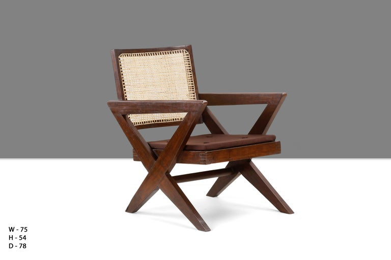 "Rare armchair known as ""Cross easy chair"" in solid teak and braided canework, circa 1955-1956. We have two of them to offer. PJ-SI-45-A for Chandigarh.   This chair is a fantastic piece, almost iconic. It is raw in its simplicity and"