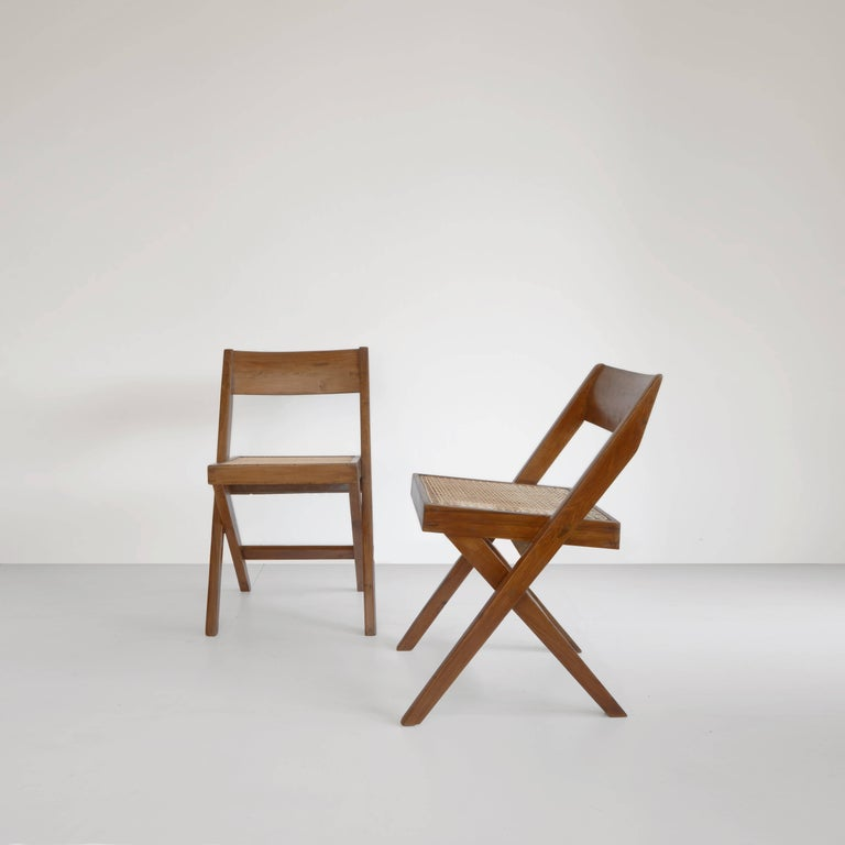 Chair, 1959-1960. Designed for the University Library and the High Court. Completely restored. Wonderful patina on the fantastic teak. Cane is redone in 2016. You get an cushion too. A simple looking chair with a minimalistic shape. We have several