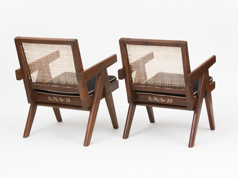 Original teak and wicker low lounge chairs with cushion, designed by Pierre Jeanneret for the famous modernist capital city of Chandigarh, India that was designed by Le Corbusier, Jeanneret and their team.