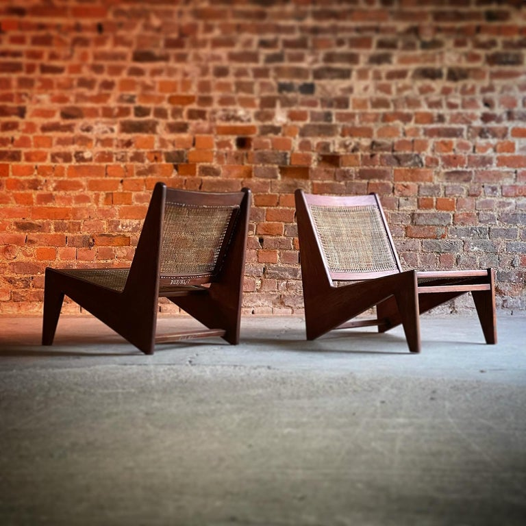 """Pierre Jeanneret Model: CH010607 Kangourou Low Chairs Teak & Cane Chandigarh   Rare pair of Pierre Jeanneret Model: CH010607 Low chairs also known as the """"Kangourou"""