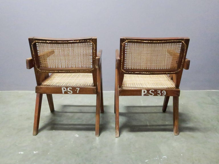"Pair of original ""V-leg"" armchairs by Pierre Jeanneret from Chandigarh, India. Chairs have been cleaned and re-caned only to preserve rich patina from original use. Both chairs with numbers on back."